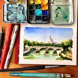 Art supplies including watercolor, pens, and paintbrush