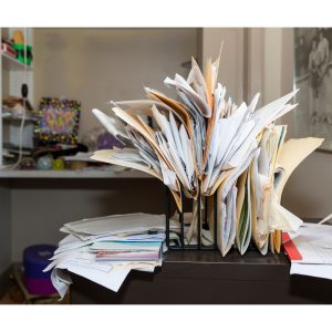 Photo of messy paper files on a desk