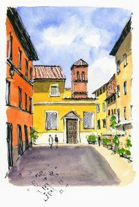 yellow and orange buildings and blue sky in Italian neighborhood